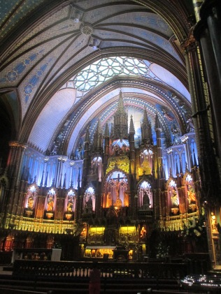 I overheard a tour guide say that the designer, François Baillairgé, was inspired by the amazing Sainte-Chapelle in Paris.