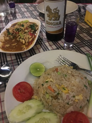 Crab fried rice and locally-brewed beer